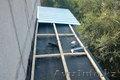 Козырек над балконом последнего этажа в Алматы